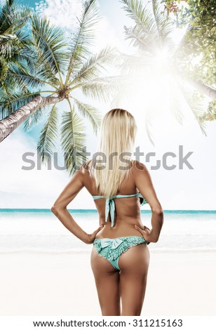 Attractive and sexy girl on the tropical  beach - stock photo