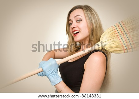 Attractive and sexy housewife is going to fight dirty - stock photo