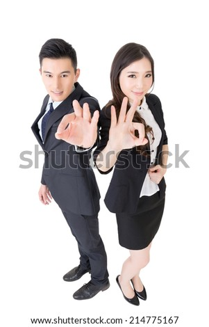 Attractive Asian business woman and man give you an okay sign, full length portrait isolated on white. - stock photo