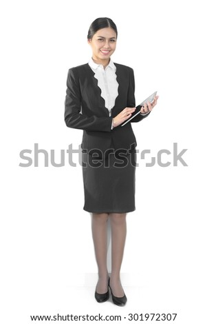 Attractive asian business women use tablet computer - stock photo