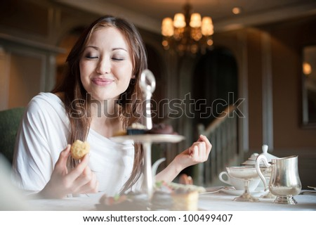 Attractive Asian Female Enjoying Desserts - stock photo