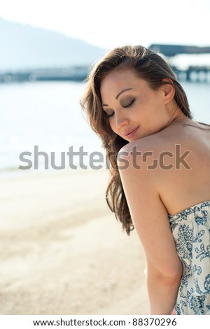 Attractive Asian Female looking shy - stock photo