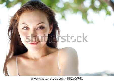 Attractive asian female smiling - stock photo