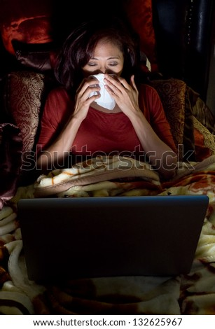 Attractive asian filipino woman on her bed - stock photo