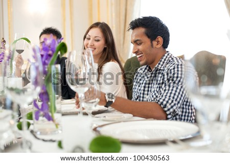 Attractive Asian Friends at a Restaurant - stock photo