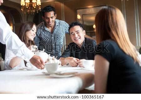 Attractive Asian Friends in Restaurant - stock photo