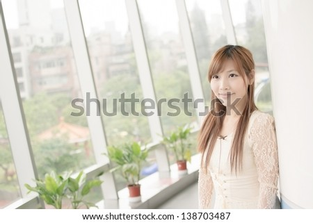 Attractive Asian girl, closeup portrait in modern city. - stock photo