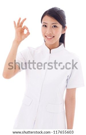 attractive asian nurse showing okay sign on white background - stock photo