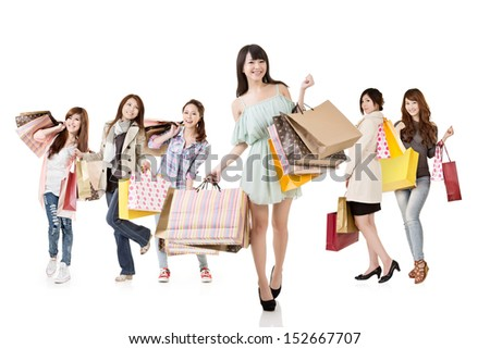 Attractive asian shopping women, with girl in front, walk and look at the camera. Group full length portrait. Isolated on white background. - stock photo
