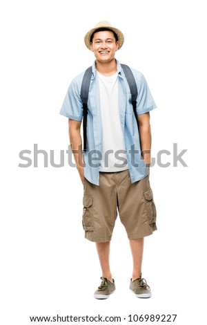 Attractive Asian tourist man smiling on white background - stock photo