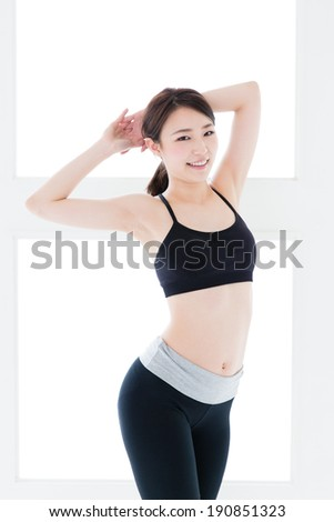 attractive asian woman exercising in the sport gym - stock photo