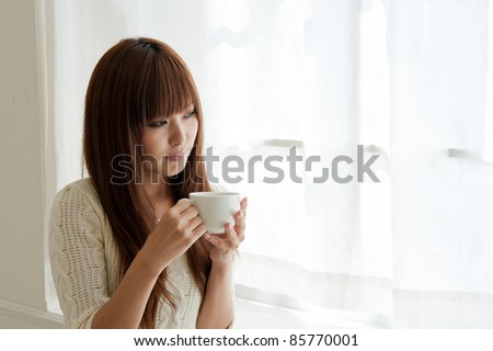 attractive asian woman relaxing in the room? - stock photo