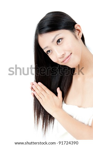 attractive asian woman taking care of her hair - stock photo
