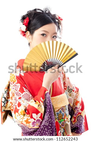 attractive asian woman wearing japanese kimono holding traditional fan on white background - stock photo