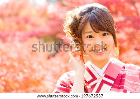 attractive asian woman wearing traditional japanese kimono  - stock photo