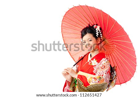 attractive asian woman wearing traditional japanese kimono and red umbrella on white background - stock photo