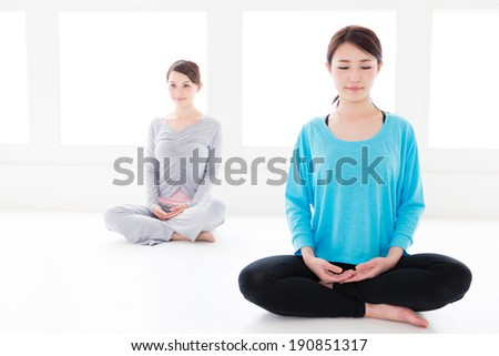 attractive asian women exercising in the sport gym - stock photo