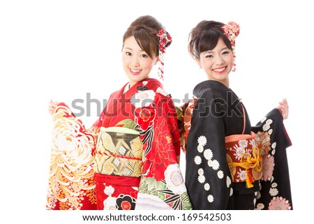 attractive asian women wearing traditional japanese kimono on white background - stock photo