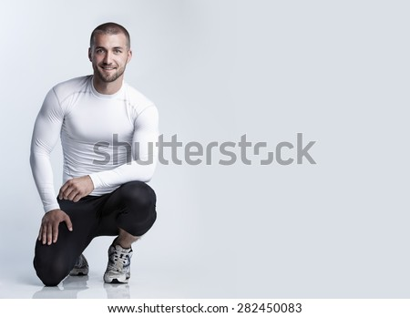 Attractive athlete in sports dress - stock photo