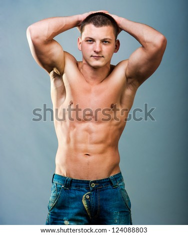 attractive athletic man holding his hands behind his head - stock photo