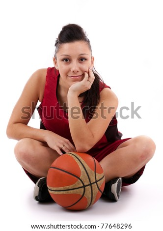 Attractive basketball player with ball - stock photo