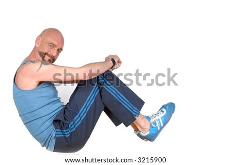 Attractive bearded middle aged man exercising, fitness, sport concept - stock photo