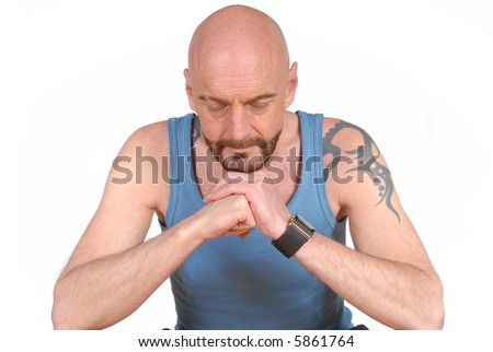 Attractive bearded middle aged man in sports outfit meditating, fitness, mental health concept - stock photo