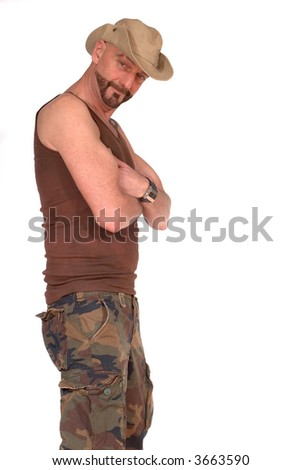 Attractive bearded middle aged man with tattoo and hat, camouflage outfit, military lifestyle concept - stock photo