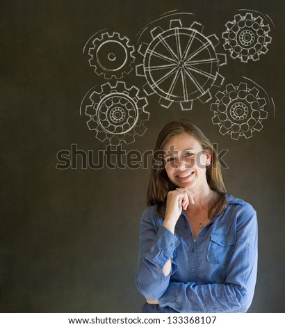 Attractive beautiful business woman, student or teacher thinking with turning gear cogs or gears - stock photo