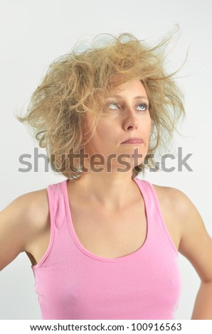 Attractive beautiful woman with messy hair - stock photo