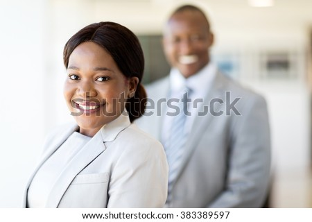 attractive black business woman looking at the camera - stock photo