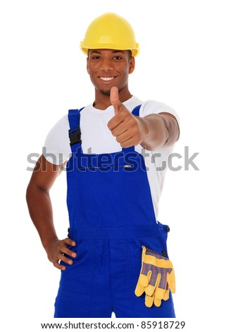 Attractive black manual worker showing thumbs up. All on white background. - stock photo