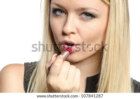 attractive blond girl with pomade - stock photo