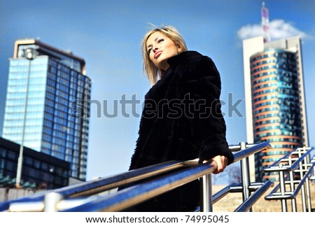 Attractive blond woman in downtown. - stock photo