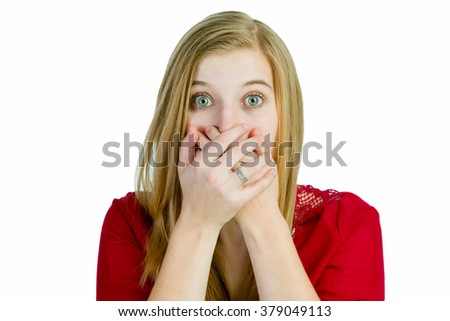 Attractive blond woman is shocked or surprised - stock photo