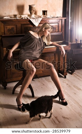 Attractive blond woman posing in a vintage room - stock photo