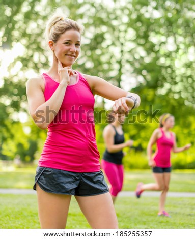 attractive blond woman taking her pulse - stock photo