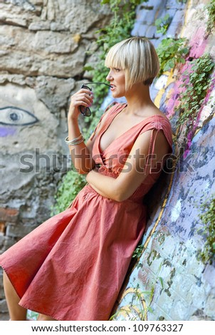 attractive blond woman thinking outside - stock photo