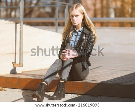 Attractive blonde girl with beautiful long hair on a sunny day - stock photo