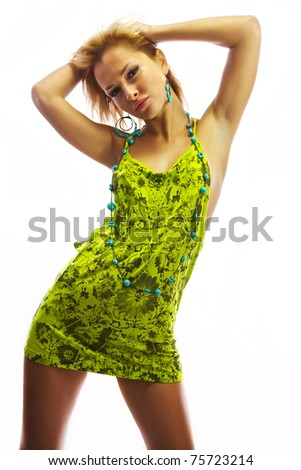 Attractive blonde in a green dress. Isolated on white. - stock photo