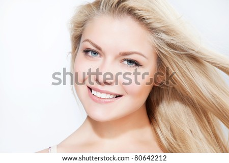 Attractive blonde smiling woman portrait on white background - stock photo