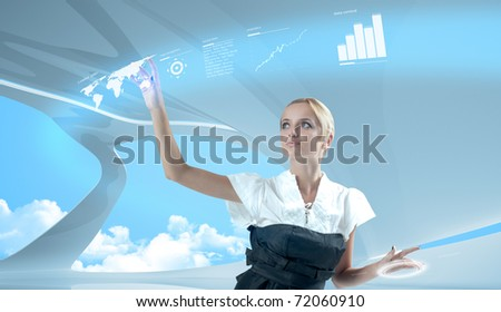 Attractive blonde touching the world map virtual future interface - stock photo