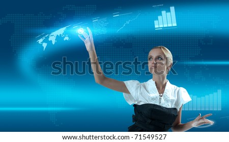 Attractive blonde using technologies of the future - stock photo