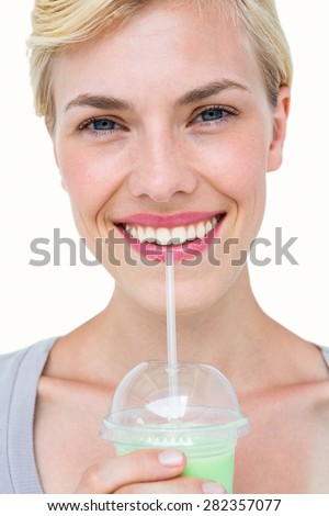 Attractive blonde woman holding healthy juice on white background - stock photo