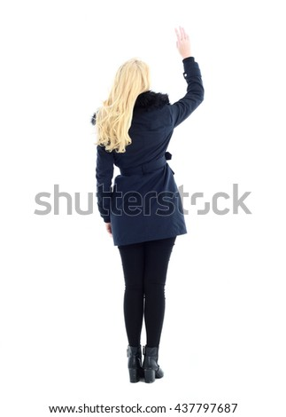 attractive blonde woman wearing dark winter coat with fur collar, standing pose. isolated against white background. - stock photo