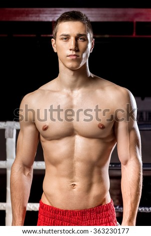 Attractive boxing champion in expressing his emotions - stock photo