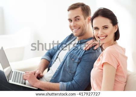 Attractive boyfriend and girlfriend resting together - stock photo