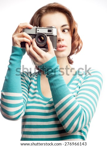 Attractive brunette aims her camera, isolated on white - stock photo