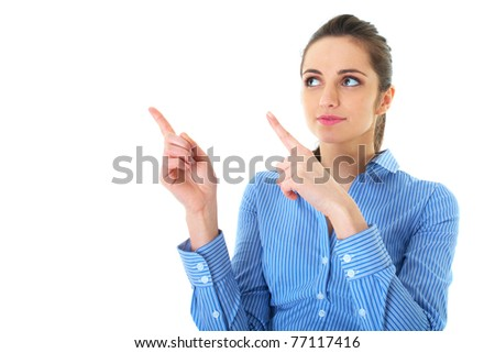 attractive brunette businesswoman points her fingers up and to the side, isolated on white - stock photo