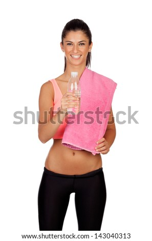 Attractive brunette girl drinking water during training the isolated on a white background - stock photo